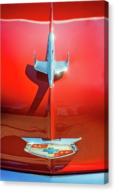 Old Truck Canvas Print - Hood Ornament On A Red 55 Chevy by Scott Norris