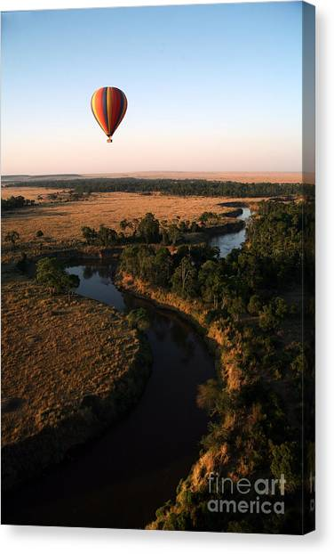 Basket Canvas Print - Hot Air Balloon Hovers Over The Winding by Paul Banton