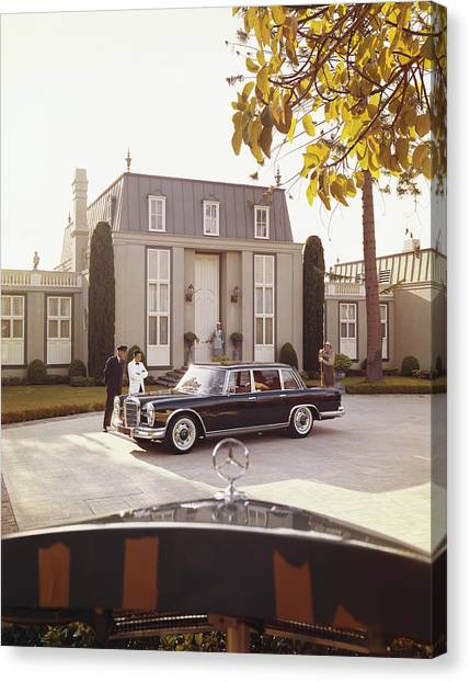 House Workers And Staff Looking At Car Canvas Print