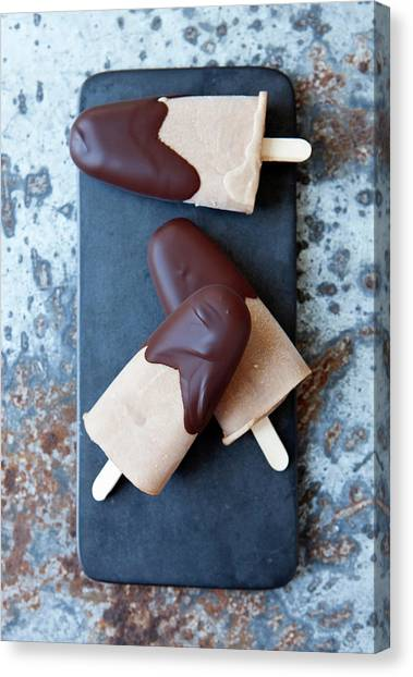 Ice Cream Bars Dipped In Chocolate Canvas Print by Cultura Rf/line Klein