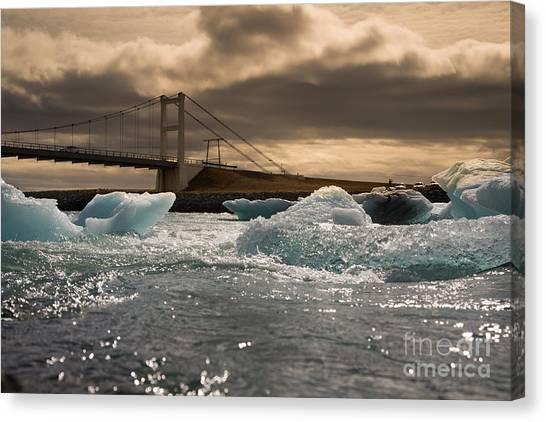 Change Canvas Print - Iceberg Drifting To Sea At Jokulsarlon by Menno Schaefer