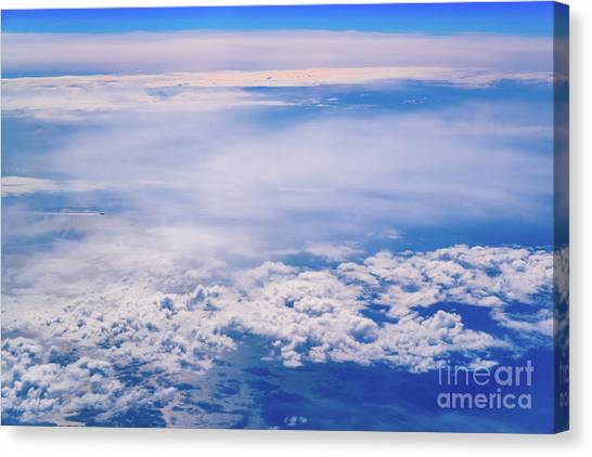 Intense Blue Sky With White Clouds And Plane Crossing It, Seen From Above In Another Plane. Canvas Print