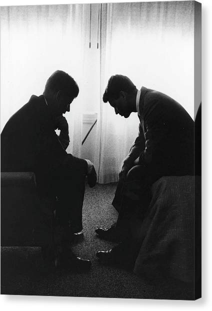 John Kennedy Confers With Robert Kennedy Canvas Print by Hank Walker