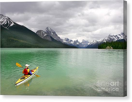 Kayaking In Banff National Park, Canada Canvas Print by Oksana.perkins