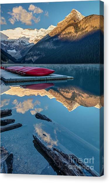 Canoe Canvas Print - Lake Louise Canoes In Banff National by Pierre Leclerc