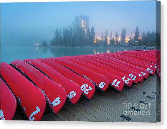 Foggy Forests Canvas Print - Lake Louise Red Canoes by Inge Johnsson