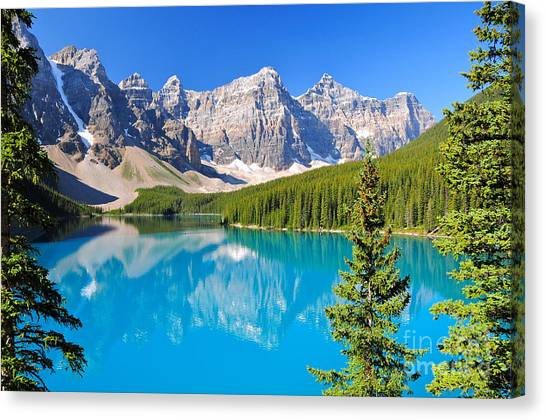 Canoe Canvas Print - Lake Moraine, Ab, Canada by Richard Cavalleri