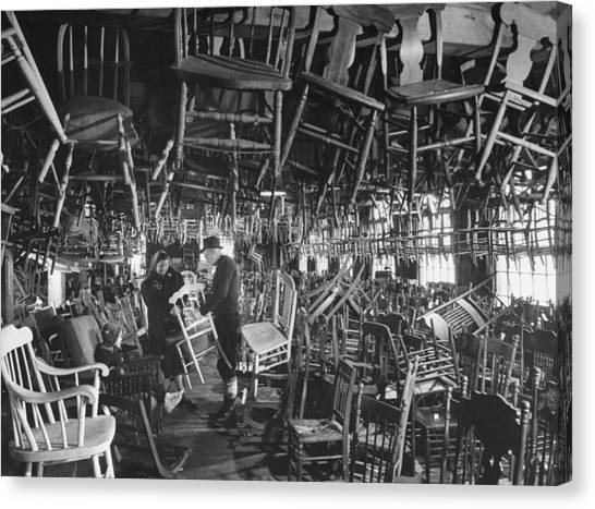 Large Room Full Of Chairs Being Offered Canvas Print by Walter Sanders