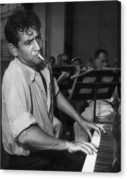 Leonard Bernstein Smoking At Piano Canvas Print by Bettmann