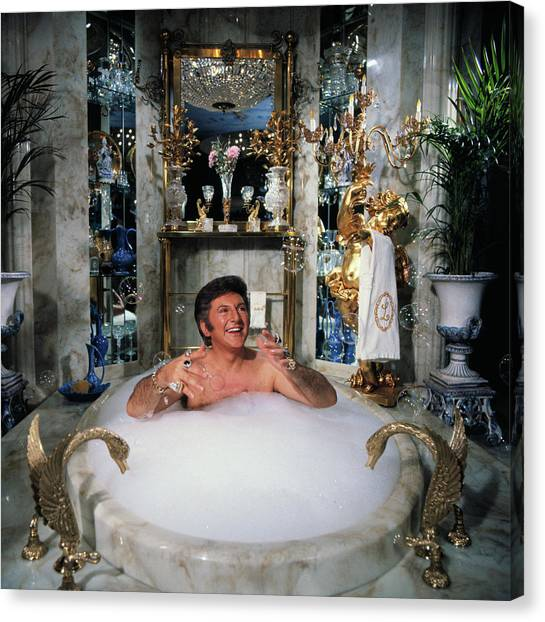 Liberace Taking A Bubble Bath Canvas Print by Bettmann