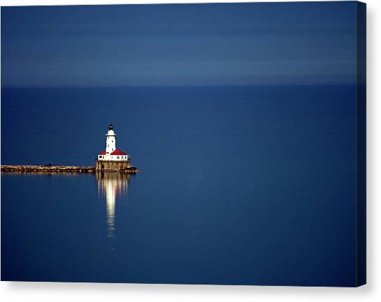 Lighthouse On A Lake Canvas Print