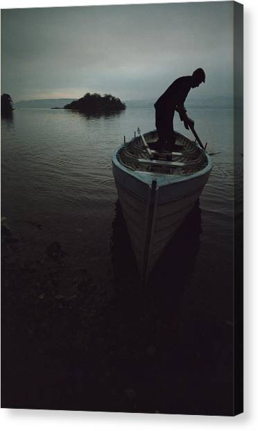 Lone Rower At Shore Canvas Print