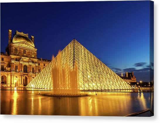 Parisian Canvas Print - Louvre At Twilight by Andrew Soundarajan