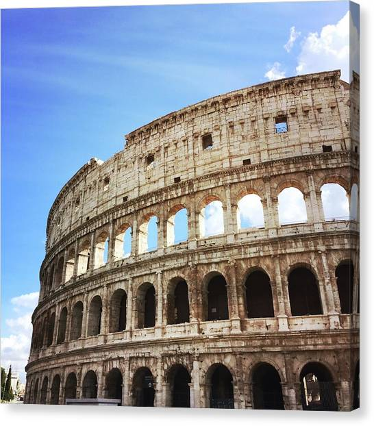 Low Angle View Of Coliseum Against Sky Canvas Print by Kate Dalton / Eyeem