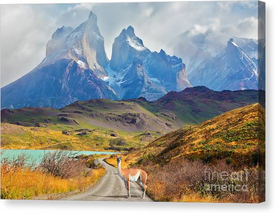 Cliffs Canvas Print - Majestic Peaks Of Los Kuernos Over Lake by Kavram