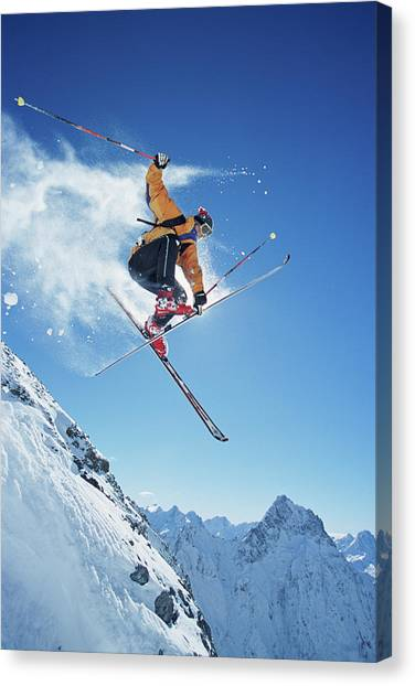 Male Skier In Mid-air, Low Angle View Canvas Print