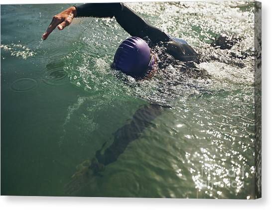 Exercising Canvas Print - Male Swimmer Swimming In Open Water by Jacob Lund
