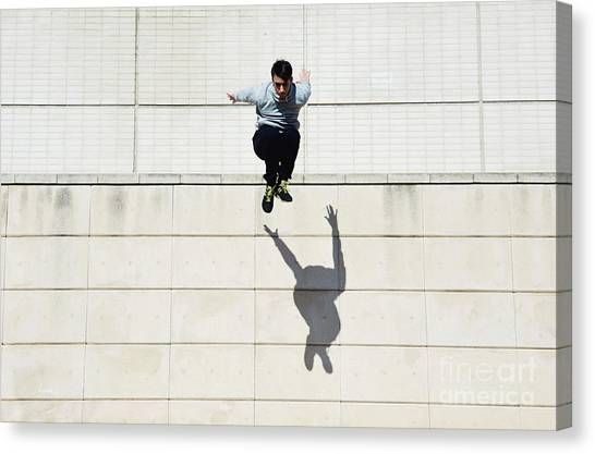Exercising Canvas Print - Male Tracer Free Runner Jumping Forward by Gaudilab