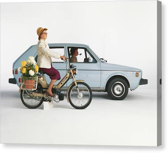 Man Driving Car And Woman Riding Canvas Print