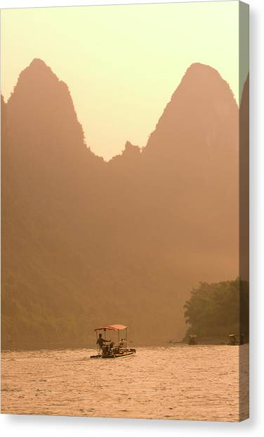 Man In Bomboo Raft On Li River At Sunset Canvas Print