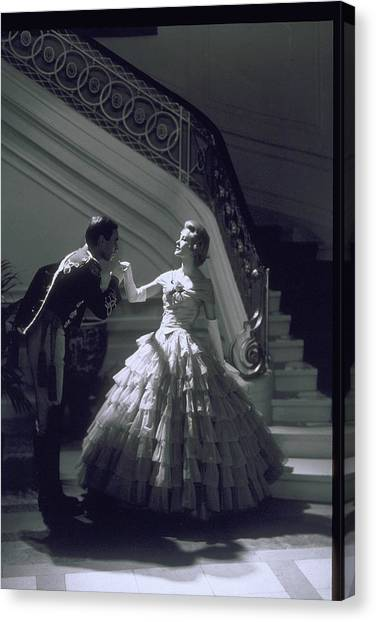 Man Kisses Hand Of Woman In Ball Gown Canvas Print by Archive Holdings Inc.