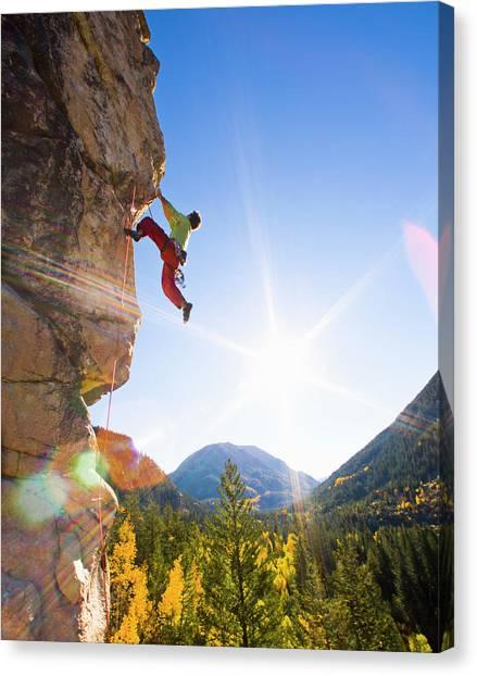 Man Rock Climbing, Dangling From Canvas Print