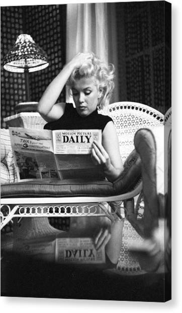 Marilyn Relaxes In A Hotel Room Canvas Print by Michael Ochs Archives
