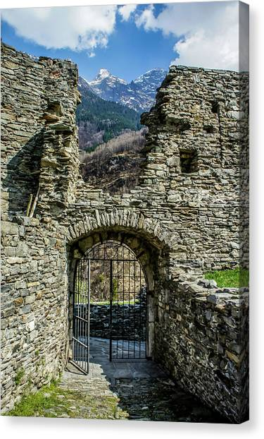 Canvas Print featuring the photograph Mesocco Castle Gate With Mountains by Dawn Richards