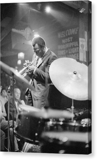 Miles Davis Performing In Nightclub Canvas Print by Bettmann