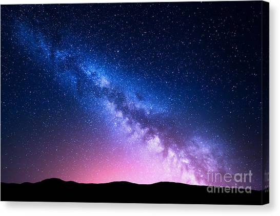Beauty Canvas Print - Milky Way And Pink Light At Mountains by Denis Belitsky
