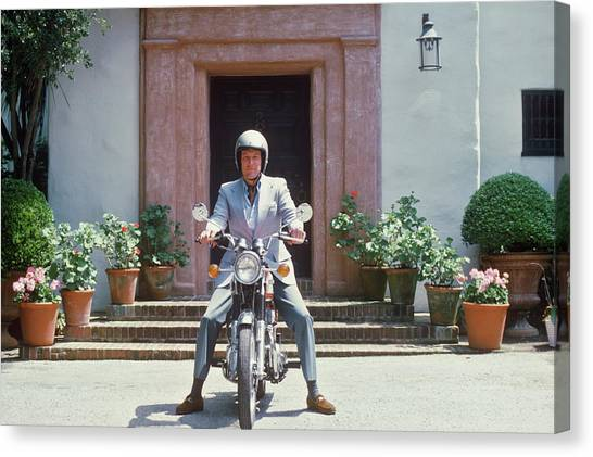 Mitchell On Motorcycle Canvas Print by Slim Aarons