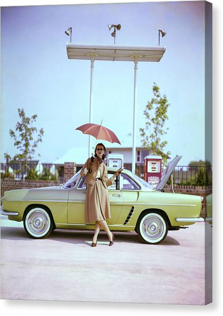 Model In Front Of A Gold Renault Caravelle Canvas Print by Jerry Schatzberg
