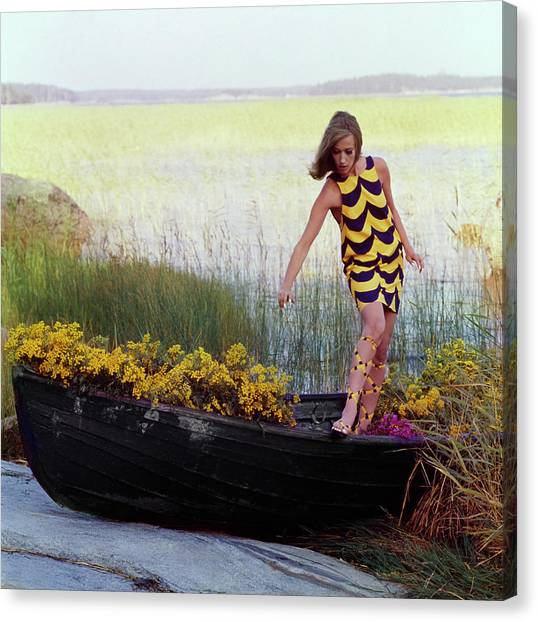 Model In Rowboat Filled With Yellow Flowers Canvas Print by Gordon Parks