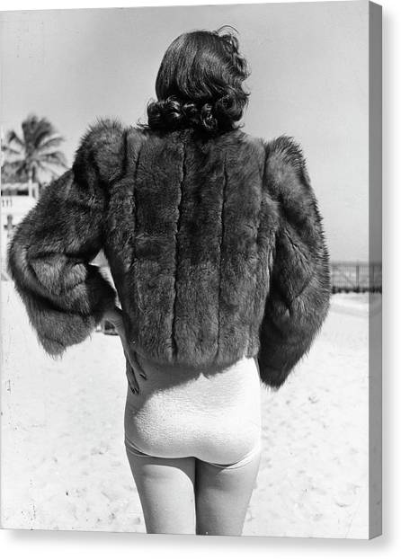 Model Wearing Fur Jacket Over Bathing Su Canvas Print