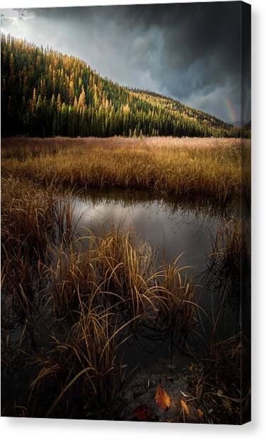 Canvas Print featuring the photograph Moody Skies And Rainbows / Whitefish, Montana  by Nicholas Parker