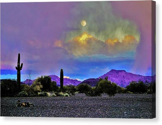 Moon At Sunset In The Desert Canvas Print