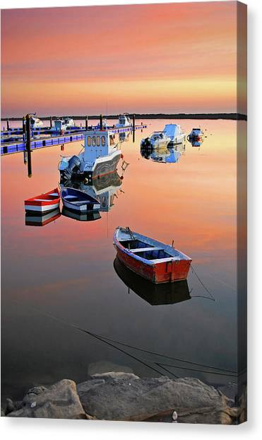 Moored Boats On Sea At Sunset Canvas Print