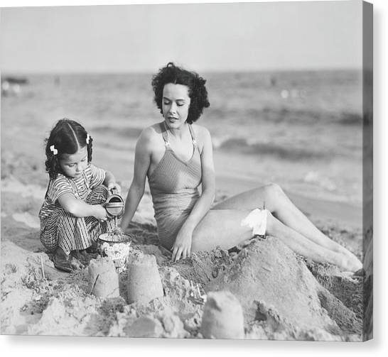 Mother With Girl 2-3 Playing In Sand On Canvas Print