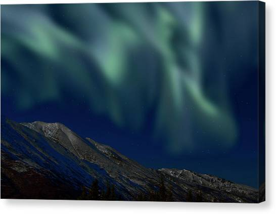 Mountain & Northern Lights Canvas Print by Mark Newman