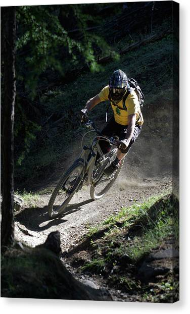 Mountain Biker On Dirt Path Canvas Print