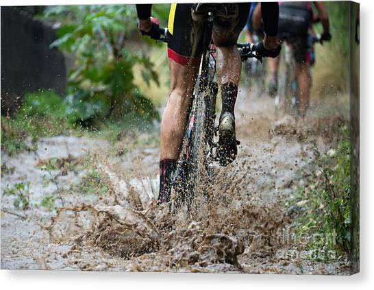 Mountain Bikers Driving In Rain Canvas Print by Pavel1964