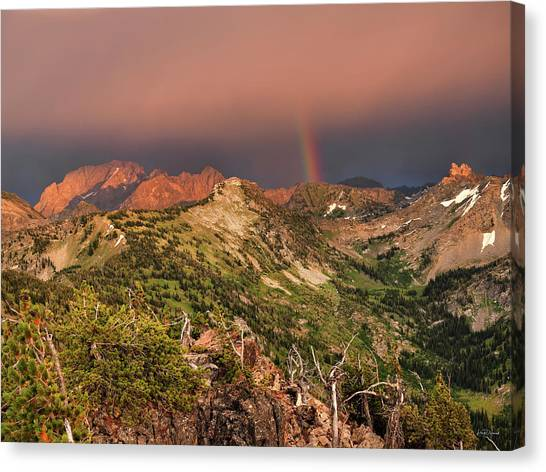Mountain Light And Rainbow In The Tetons Canvas Print by Leland D Howard