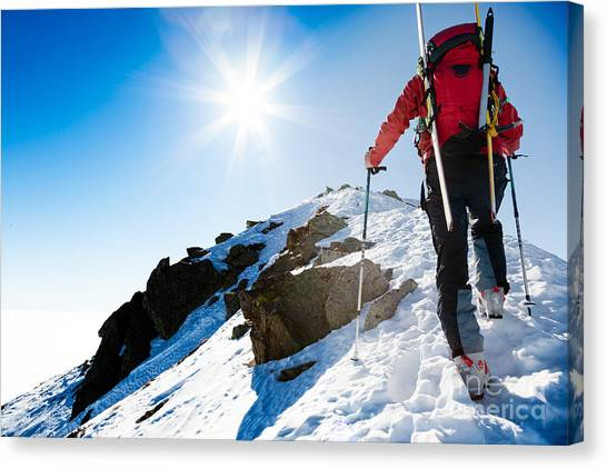 Ice Climbing Canvas Print - Mountaineer Walking Up Along A Snowy by Roberto Caucino