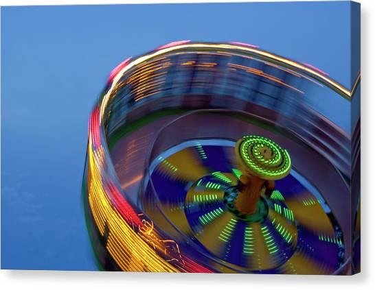 Multicolored Spinning Carnival Ride Canvas Print by By Ken Ilio