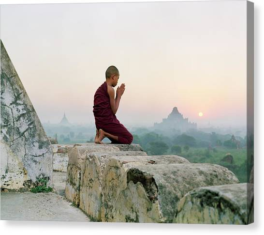 Myanmar, Bagan, Buddhist Monk Praying Canvas Print