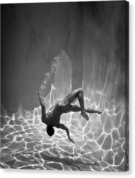 Naked Man Underwater Canvas Print by Ed Freeman