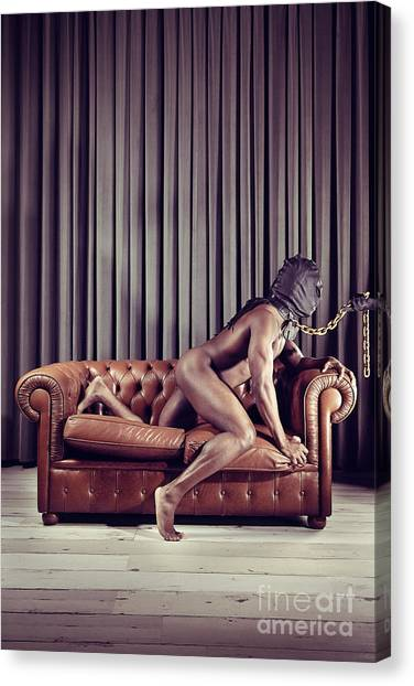 Naked Man With Mask On A Sofa Canvas Print