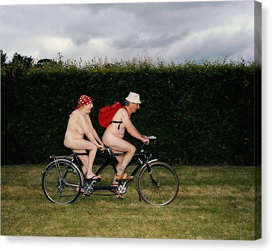 Naked Mature Couple Riding Tandem Canvas Print