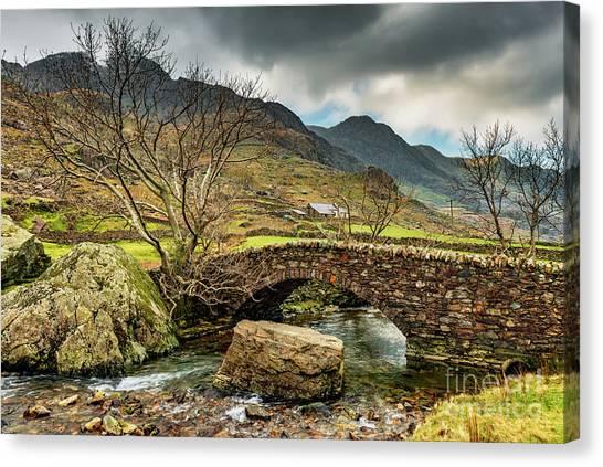 Snow Bank Canvas Print - Nant Peris Bridge Snowdonia by Adrian Evans