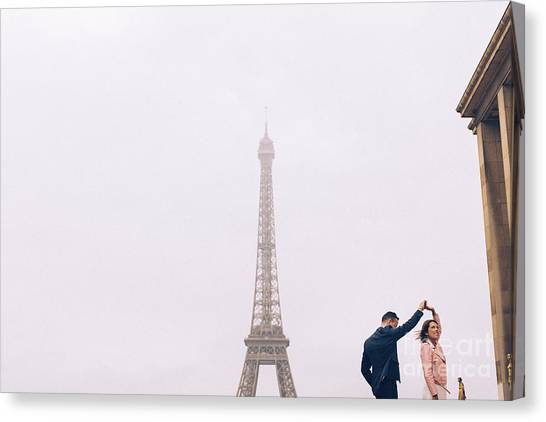 Newly-wed Couple On Their Honeymoon In Paris, Loving Having A Date Near The Eiffel Tower Canvas Print